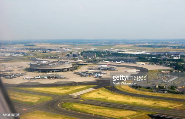 paris charles de gaulle airport. - charles de gaulle airport stock photos and pictures
