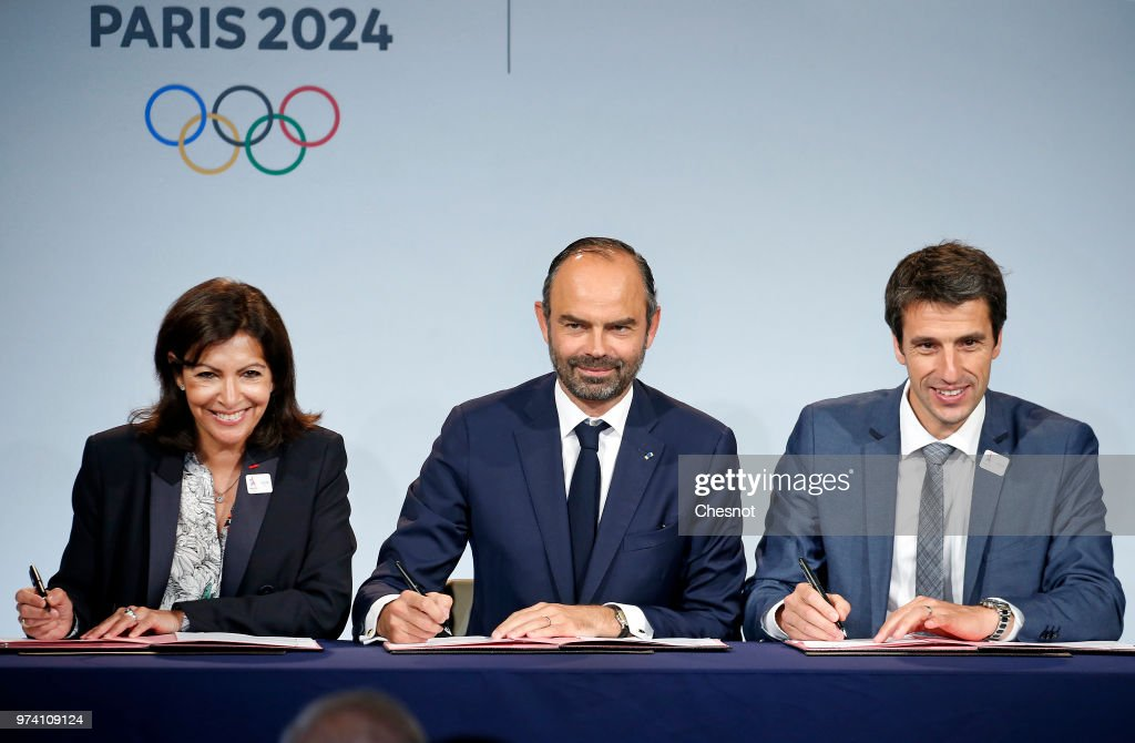 Paris city mayor Anne Hidalgo (L), French Prime Minister Edouard Philippe (C) and International Olympic Committee (IOC) member and Co-Chairman of Paris 2024 Tony Estanguet (R) sign the protocol of organization of the Olympic and Paralympic Games 2024, at the Paris City Hall on June 14, 2018 in Paris, France. The city of Paris will host the 2024 Summer Olympic and Paralympic Games.