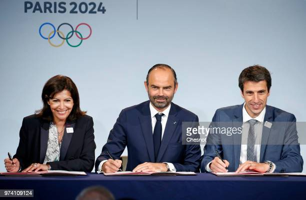 Paris city mayor Anne Hidalgo , French Prime Minister Edouard Philippe and International Olympic Committee member and Co-Chairman of Paris 2024 Tony...