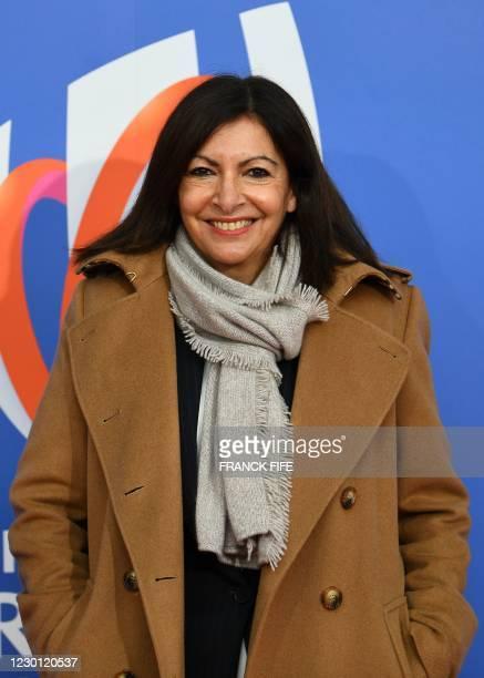 Paris' city mayor Anne Hidalgo poses on the red carpet as she arrives on December 14, 2020 in Paris, to attend the draw for the 2023 Rugby Union...