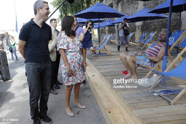 Paris city Mayor Anne Hidalgo talks with tourists as she inaugurates Paris Plage on July 8 2017 in Paris France Paris Plage opens annually to the...