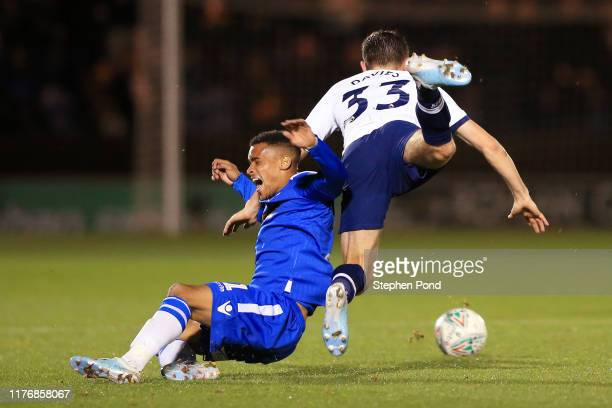 Paris Cowan-Hall of Colchester United is challenged by Ben Davies of Tottenham Hotspur during the Carabao Cup Third Round match between Colchester...