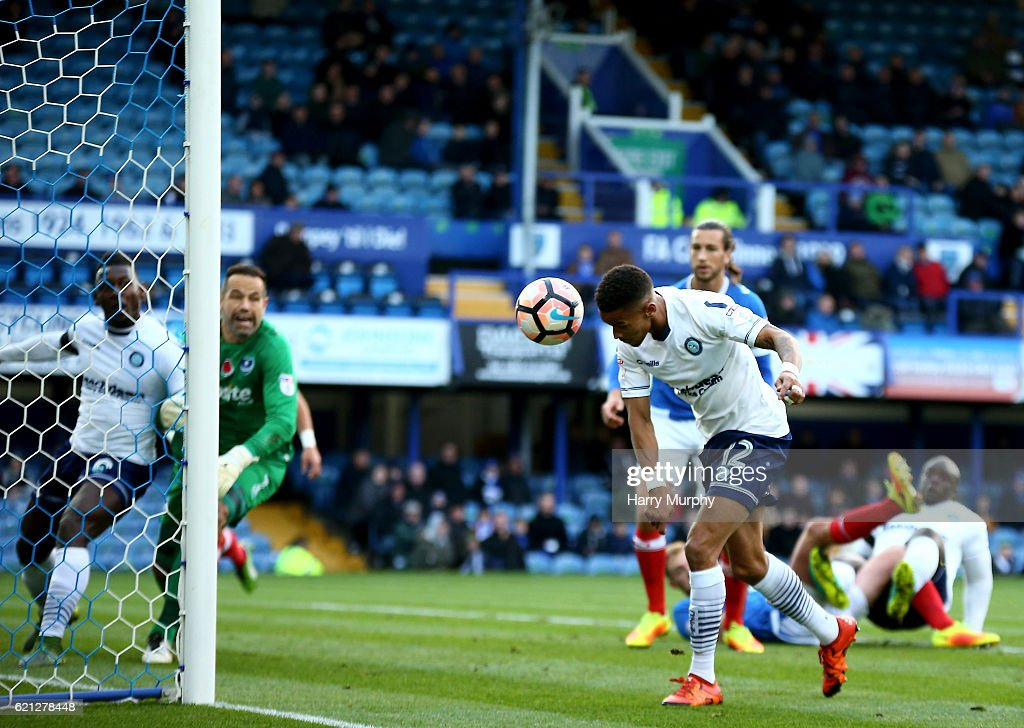 Paris Cowan-Hall of Wycombe heads home his teams opening goal during the Emirates FA Cup First Round match between Portsmouth and Wycombe Wanderers at Fratton Park on November 5, 2016 in Portsmouth, England.