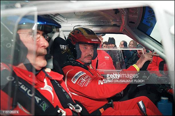 Paris Dakar car rally first stage Departure from Chateauroux France on December 29 2001 Rene Metge and Johnny Hallyday
