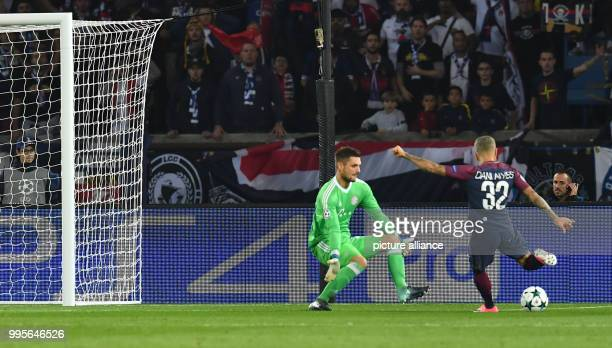 Paris' Dani Alves scores the 10 aginst Munich's goalkeeper Sven Ulreich during UEFA Champions League Group B soccer match at the Parc des Princes...