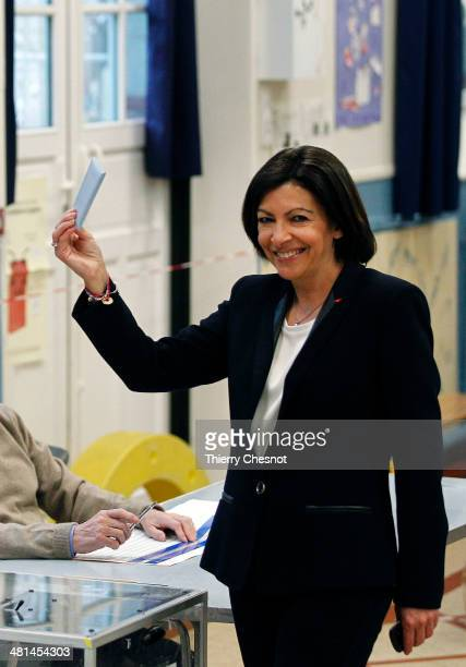 Paris Deputy Mayor and French Socialist party candidate for the Paris municipal elections, Anne Hidalgo, poses as she casts her ballot in the second...