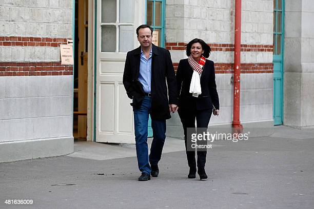 Paris Deputy Mayor and French Socialist party candidate for the Paris municipal elections, Anne Hidalgo, leaves with her husband Jean-Marc Germain...