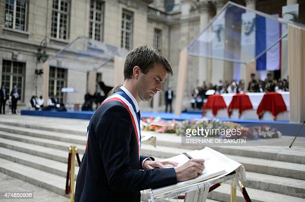 Paris Deputy Mayor Bruno Julliard signs the golden book next to the coffins of French Resistants during World War II Genevieve de GaulleAnthonioz and...