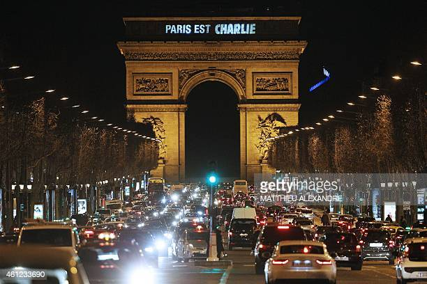 'Paris est Charlie' is projected onto the Arc de Triomphe in Paris on January 9 to pay tribute to the victims of a deadly attack on the Paris...