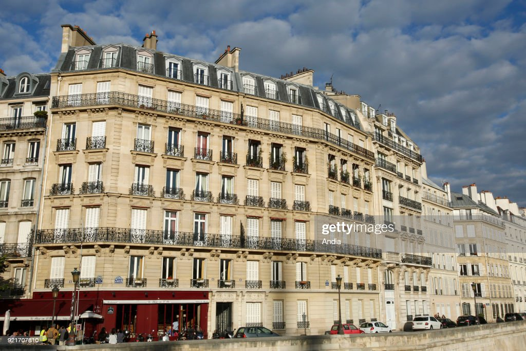 facade of buildings in the district of L'ile Saint-Louis, quai d'Orleans, on the banks of the Seine River, in the 4th arrondissement (district).