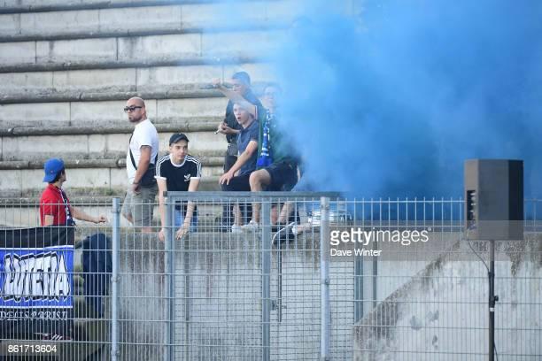 Paris FC fans left off a smoke bomb during the women's Division 1 match between Paris FC and Paris Saint Germain on October 15 2017 in Paris France