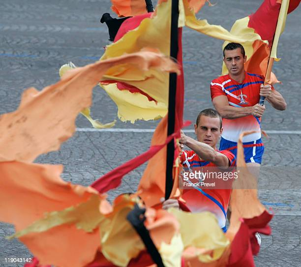 Paris firemen perform on the ChampsElysees during the annual Bastille day parade on July 14 2011 in Paris France The French National Day celebrates...