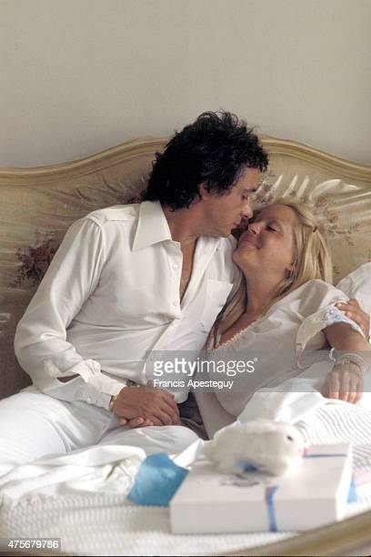 Paris France Michel Sardou with his second wife Elisabeth Haas known as Babette in the maternity clinic for the birth of their second son Davy