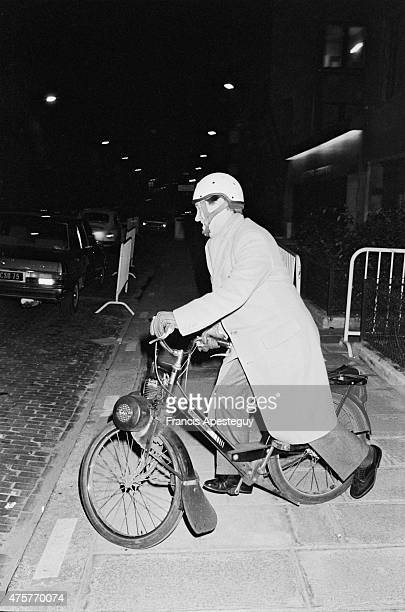 Paris France Alain Duhamel with his velo solex