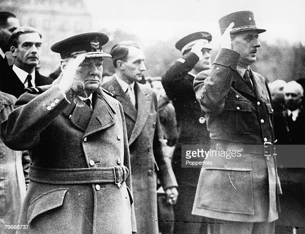 Paris France 13th November British Prime Minister Winston Churchill and General Charles De Gaulle salute the tomb of France's Unknown Soldier during...