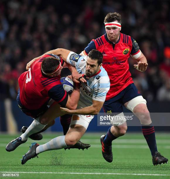 Paris France 14 January 2018 CJ Stander of Munster is tackled by Rémi Tales of Racing 92 during the European Rugby Champions Cup Pool 4 Round 5 match...