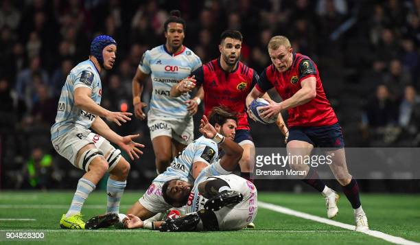 Paris France 14 January 2018 Keith Earls of Munster steps into touch after evading the tackle of Leone Nakawara of Racing 92 during the European...
