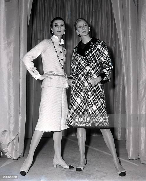 Paris France 21st July 1970 Models display a beige tweed skirt suit and plaid grey coat by French designer Coco Chanel being modelled in Paris
