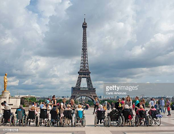 CONTENT] Paris France 23 June 2013 Group of elderly tourists on wheelchairs on a guided tour in front of the Eiffel Tower