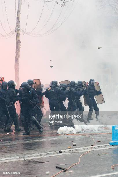 Paris France 24 novembrer 2018 Police forces are trying to contain the demonstrators during a protest of Yellow vests against rising oil prices and...