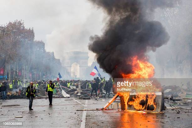 Paris France 24 novembrer 2018 Protestors stand in front of the police during a protest of Yellow vests against rising oil prices and living costs...