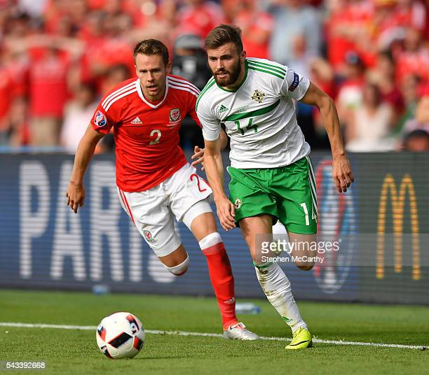 Paris France 25 June 2016 Stuart Dallas of Northern Ireland in action against Chris Gunter of Wales during the UEFA Euro 2016 Round of 16 match...
