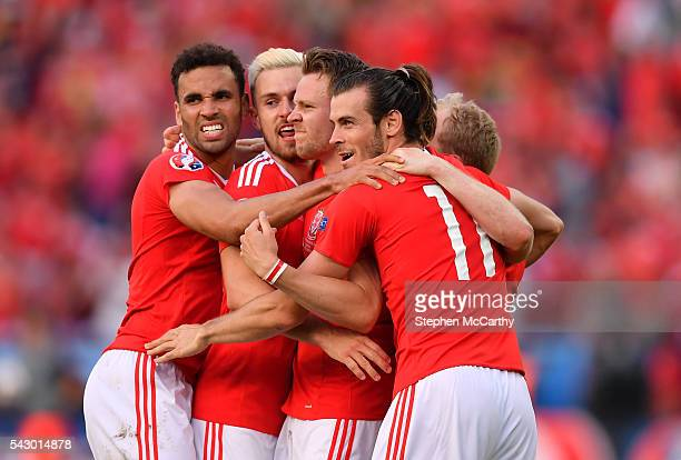 Paris France 25 June 2016 Wales players form left Hal RobsonKanu Aaron Ramsey Chris Gunter and Gareth Bale celebrate following the UEFA Euro 2016...