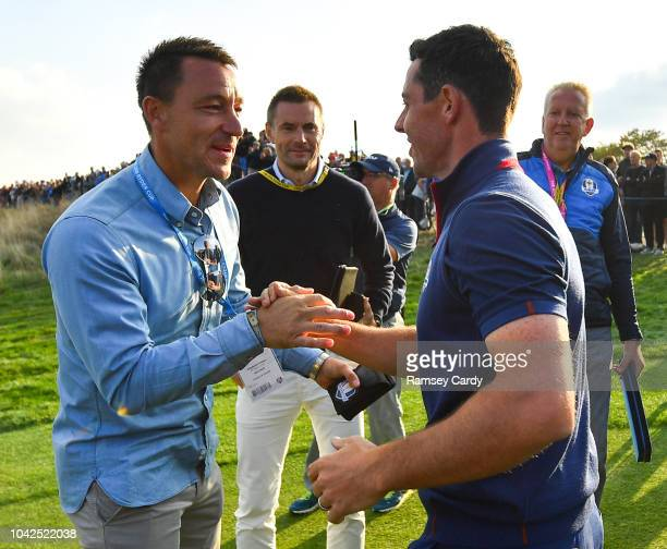 Paris France 28 September 2018 Rory McIlroy of Europe right and professional footballer John Terry following his Afternoon Foursome Match against...