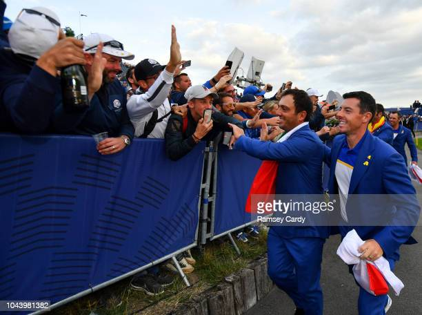 Paris France 30 September 2018 Francesco Molinari left and Rory McIlroy of Europe celebrate with supporters after winning the Ryder Cup following the...
