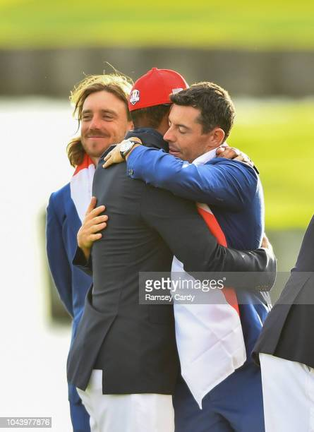 Paris France 30 September 2018 Rory McIlroy of Europe hugs Tiger Woods of USA with Tommy Fleetwood to their left after the Ryder Cup 2018 Matches at...