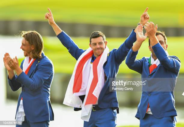 Paris France 30 September 2018 Tommy Fleetwood left with Rory McIlroy centre and Francesco Molinari of Europe after the Ryder Cup 2018 Matches at Le...