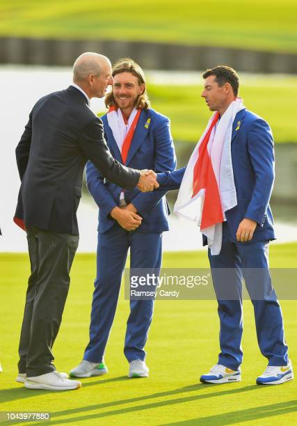 Paris France 30 September 2018 USA captain Jim Furyk left shakes ands with Rory McIlroy of Europe as Tommy Fleetwood centre looks on after the Ryder...