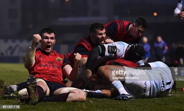 Paris France 7 January 2017 Munster captain Peter OMahony celebrates as teammate CJ Stander goes over for his side's second try during the European...