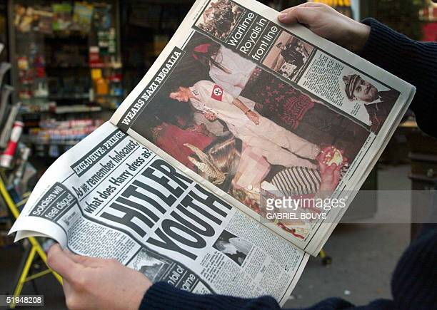 A man reads 13 January 2005 in Paris the British tabloid The Sun featuring Harry the younger son of Prince Charles and the late Princess Diana...
