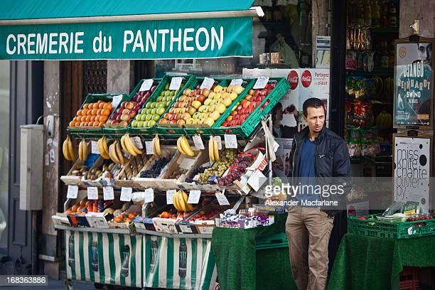 Paris, France A man stand outside his vegetable shop in Paris.