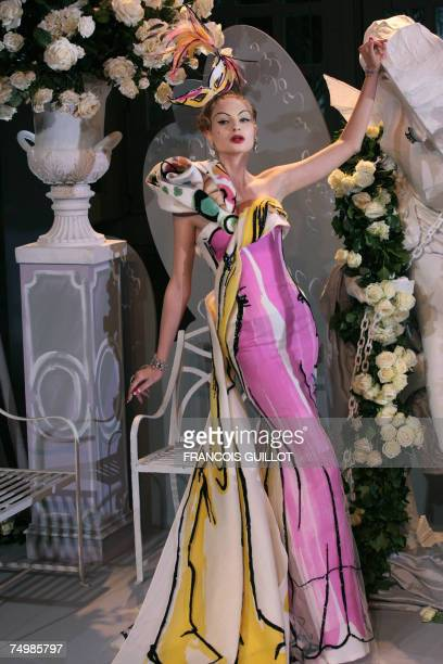 A model presents a creation by British designer John Galliano for Christian Dior Fall/Winter 200708 Haute Couture collection show 02 July 2007 in...