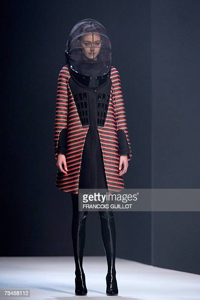 A model presents a creation by Britishbased Turkish Cypriot designer Hussein Chalayan during the Autumn/Winter 2007/2008 readytowear collection show...