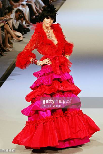 A model presents a creation by French designer Christian Lacroix during the Fall/Winter 200607 Haute Couture collections 06 July 2006 in Paris AFP...