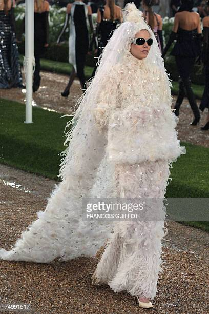 A model presents a creation by German designer Karl Lagerfeld for Chanel Fall/Winter 200708 Haute Couture collection show 03 July 2007 in Paris AFP...
