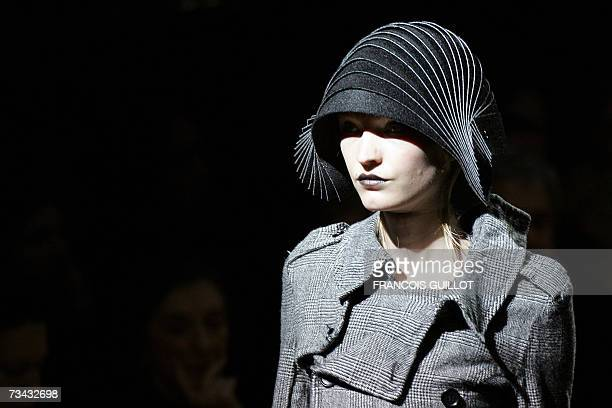 Model presents a creation by Japanese designer Junya Watanabe during the Autumn/Winter 2007/2008 ready-to-wear collection show in Paris, 27 February...