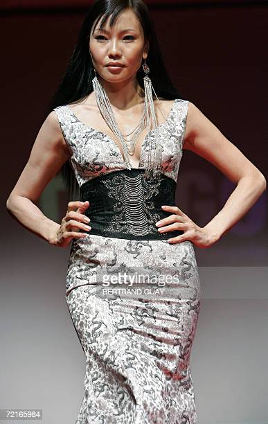 A model presents a creation of Mongolian designer Torgo during a couture runway as part of the 3rd edition of the Paris' Ethical Fashion Show 13...
