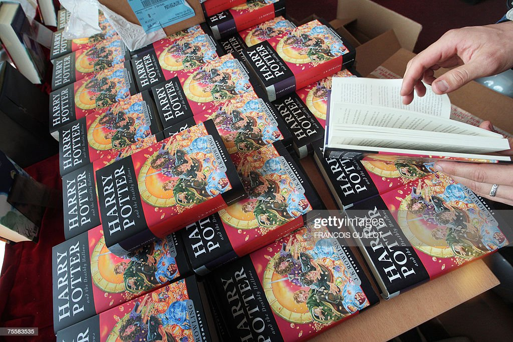 "A person reads a copy of ""Harry Potter A... : News Photo"