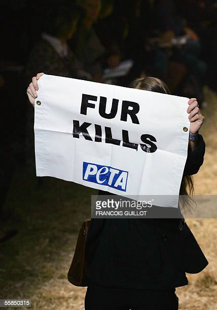 A Peta activist protests on the catwalk during French designer JeanPaul Gaultier's Spring/Summer 2006 ReadytoWear show in Paris 04 October 2005 AFP...