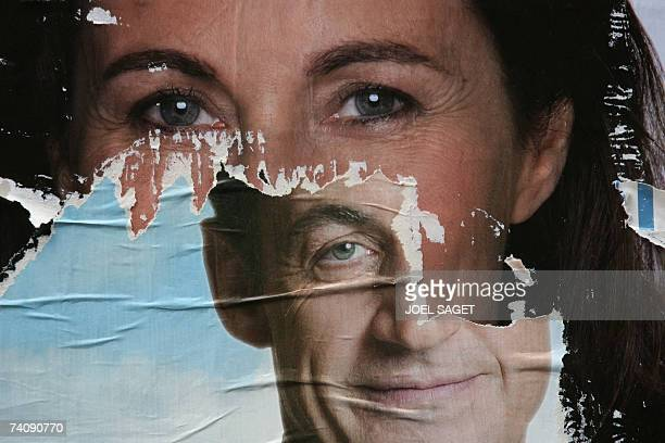 A picture taken 07 May 2007 in Paris shows a closeup of partially ripped campaign posters of French rightwing UMP presidential candidate Nicolas...