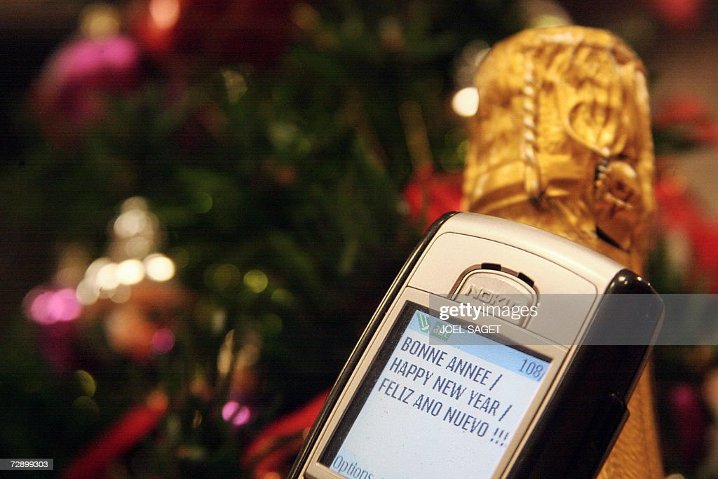an sms new year message appears on a mobile phone 28 december 2006 in paris