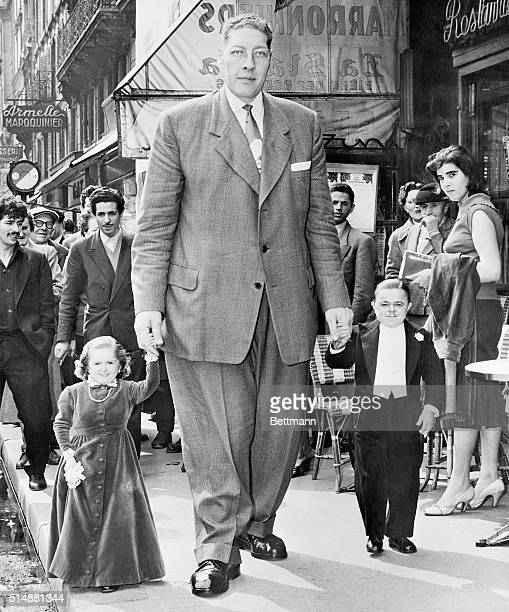 Atlas the Belgian giant and French midgets Mademoiselle margaret and Monsieur Marvel stroll along a Paris Street