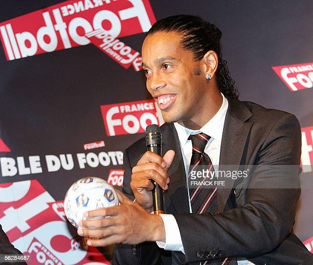 ATTENTION EMBARGO DO NOT USE BEFORE 1930GMT DO NOT USE BEFORE 1930GMT Brazilian Barcelona midfielder Ronaldinho speaks to journalists after being...