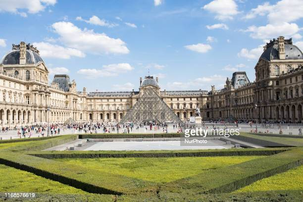 Paris, France, August 31, 2019. A view of the pyramid of the Louvre in the Napoleon courtyard by day in good weather.