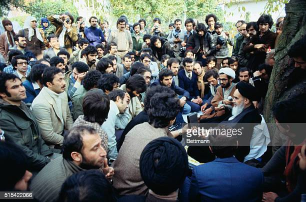 Ayatollah Ruhollah Khomeini exiled chief of the religious opposition to the shah of Iran is surrounded by about 200 Iranian students some of them...