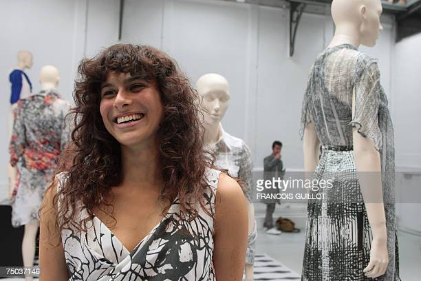 Belgian designer Cathy Pill smiles during her Fall/Winter 200708 Haute Couture collection show 05 July 2007 in Paris AFP PHOTO FRANCOIS GUILLOT